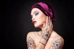 Beautiful woman in oriental style with mehendi in hijab Royalty Free Stock Photo