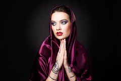 Beautiful woman in oriental style with mehendi in hijab Stock Images
