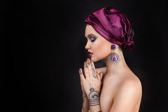 Beautiful woman in oriental style with mehendi Royalty Free Stock Photos