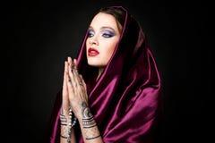 Beautiful woman in oriental style with mehendi Stock Photo
