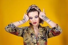 Beautiful woman in oriental style with mehendi Stock Photos
