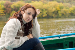 Beautiful woman out boating Stock Image