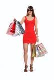 Beautiful woman out shopping wearing short dress Stock Image