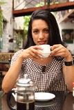 Beautiful woman at outdoor cafe drinking coffee Stock Photos