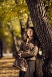 Beautiful woman outdoor. The happiness mature beautiful woman, walking outdoor in park, autumnal day Stock Photos