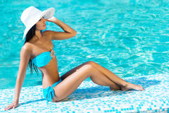 Beautiful woman in an outdoor pool Stock Photos
