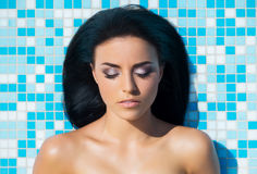 Beautiful woman in outdoor pool Royalty Free Stock Image