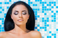 Beautiful woman in an outdoor pool. Spa portrait. Royalty Free Stock Photo