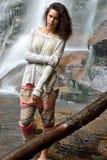 Beautiful woman outdoors - next to waterfall Royalty Free Stock Image