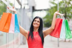 Beautiful woman outdoors with plenty of shopping bags Stock Photo