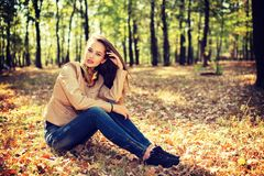 Beautiful woman outdoors in sunny day. Royalty Free Stock Images