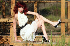Beautiful Woman Outdoors Wearing a Lace Dress Royalty Free Stock Images