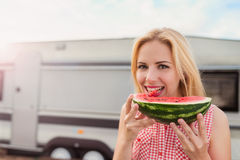 Beautiful woman outside the camper van Royalty Free Stock Photo