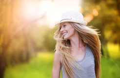 Beautiful woman outside in a park. Royalty Free Stock Image