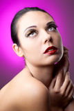Beautiful woman over color background Royalty Free Stock Images
