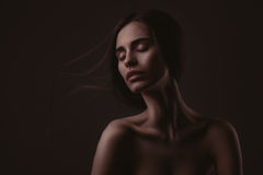 Beautiful woman over dark background Royalty Free Stock Images