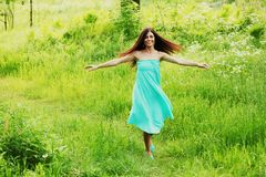 Beautiful Woman over Nature background Royalty Free Stock Image