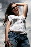 Beautiful woman over sky background Royalty Free Stock Photography