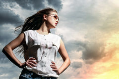 Beautiful woman over sky background Stock Image