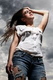 Beautiful woman over sky background Royalty Free Stock Photos