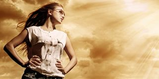 Beautiful woman over sky background Stock Photography