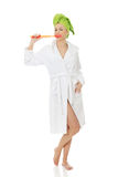 Beautiful woman with oversized toothbrush. Beautiful caucasian woman with oversized toothbrush Royalty Free Stock Photos