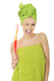 Beautiful woman with oversized toothbrush. Royalty Free Stock Image