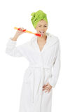 Beautiful woman with oversized toothbrush. Beautiful caucasian woman with oversized toothbrush Stock Photography