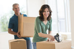 Beautiful Woman Packing Cardboard Box At Home Royalty Free Stock Photos