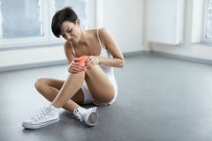 Beautiful Woman With Painful Feeling, Pain In Knee. Health Issue Royalty Free Stock Image