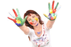 Beautiful woman with paint. The beautiful woman has stretched hands soiled in a paint upwards to a camera, on a white background, smiles.  Profile Adobe RGB ( Royalty Free Stock Image