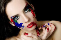 The beautiful woman with a paint on the face Royalty Free Stock Photos