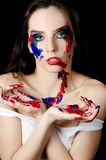 The beautiful woman with a paint on the face Stock Images