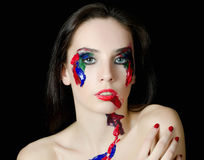 The beautiful woman with a paint on the face Stock Photos