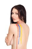Beautiful woman with paint on her back Stock Image