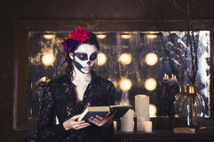 Beautiful woman painted as skeleton. Halloween theme Royalty Free Stock Image