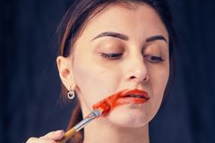 Beautiful woman painted with many vivid colors. Stock Photography