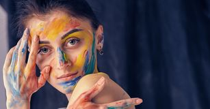 Beautiful woman painted with many vivid colors. Royalty Free Stock Images