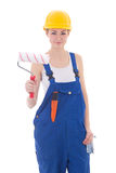Beautiful woman painter in blue coveralls and yellow helmet isol Royalty Free Stock Photos