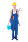 Beautiful woman painter in workwear with paintbrush and bucket i Royalty Free Stock Photography
