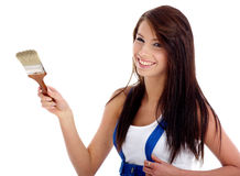 Beautiful Woman Painting A Wall Royalty Free Stock Photography