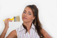 Beautiful woman painting a wall Stock Image