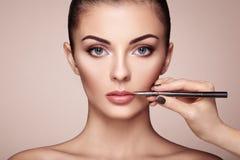 Free Beautiful Woman Paints Lips With Lipstick Royalty Free Stock Photography - 81008907