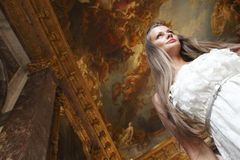 Beautiful woman in palace interior Royalty Free Stock Photo