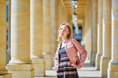 Beautiful woman in Palais Royale in Paris Stock Photography