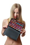 The beautiful woman with a palette eye shadow Royalty Free Stock Photography