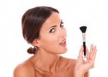 Beautiful woman with pampering make up brush Stock Image