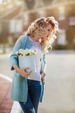 Beautiful woman with paper box of flowers Stock Images