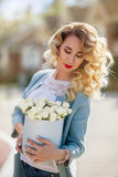 Beautiful woman with paper box of flowers Royalty Free Stock Images