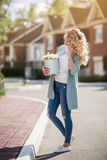 Beautiful woman with paper box of flowers Stock Photography